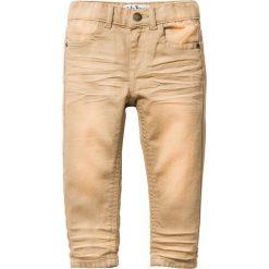 Spodnie Skinny bonprix cappuccino. Brązowe spodnie chłopięce marki bonprix, z bawełny. Za 44,99 zł.