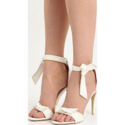 Białe Sandały Mercy. Białe sandały damskie marki Born2be, na wysokim obcasie. Za 69,99 zł.