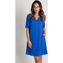 Sukienki: Niebieska trapezowa sukienka BIALCON