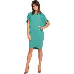 GABRIELA Sukienka tunika geometryczne cięcia - zielona. Zielone sukienki marki BE, l, w geometryczne wzory, bez rękawów, oversize. Za 129,99 zł.