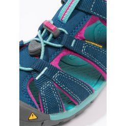 Keen SEACAMP II CNX Sandały trekkingowe poseidon/very berry. Czerwone sandały chłopięce marki Keen, z materiału. Za 239,00 zł.