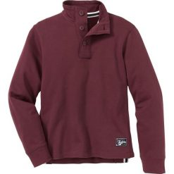 Bluza ze stójką i plisą guzikową Regular Fit bonprix czerwony klonowy. Czerwone bluzy męskie rozpinane marki KALENJI, m, z elastanu, z długim rękawem, długie. Za 74,99 zł.