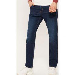 Jeansy regular classic - Granatowy. Niebieskie jeansy męskie regular House. Za 129,99 zł.