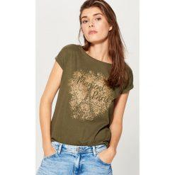 Bawełniana koszulka z nadrukiem - Khaki. Brązowe t-shirty damskie marki DOMYOS, xs, z bawełny. Za 39,99 zł.