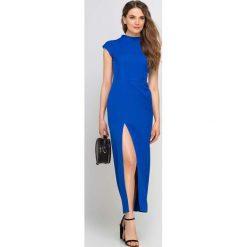 Długa Chabrowa Sukienka ze Stójką z Rozcięciem na Boku. Niebieskie długie sukienki marki ARTENGO, z elastanu, ze stójką. Za 169,90 zł.