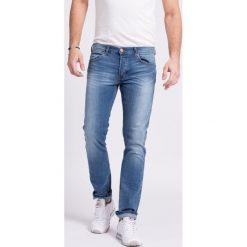 Wrangler - Jeansy Spencer Fired Up. Niebieskie jeansy męskie slim Wrangler, z bawełny. W wyprzedaży za 249,90 zł.