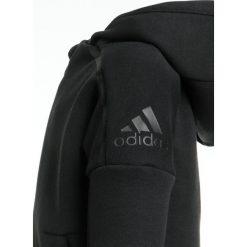 Spodnie dresowe dziewczęce: adidas Performance JOGG Dres black/black
