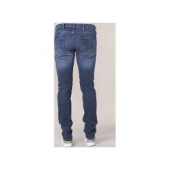 Jeansy slim fit Emporio Armani  BREWITE. Szare jeansy męskie relaxed fit marki Emporio Armani, l, z nadrukiem, z bawełny, z okrągłym kołnierzem. Za 559,20 zł.