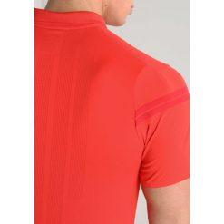 Nike Performance ROGER FEDERER  Koszulka polo habanero red/habanero red/gym. Niebieskie koszulki polo marki Nike Performance, m, z materiału. Za 319,00 zł.