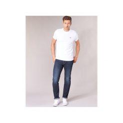 Jeansy straight leg Levis  502 REGULAR TAPER. Niebieskie jeansy męskie regular marki Adidas, m. Za 439,00 zł.