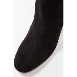 KIOMI Kozaki black. Czarne kozaki damskie skórzane marki KIOMI. W wyprzedaży za 367,20 zł.