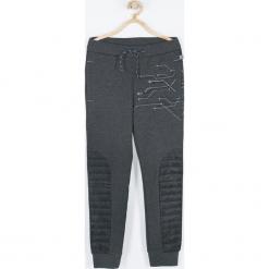 Spodnie. Czarne spodnie chłopięce TECHNOLOGY OF TOMORROW, z nadrukiem, z bawełny. Za 75,90 zł.