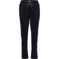 Tommy Jeans - Damskie spodnie dresowe, czarny. Szare spodnie sportowe damskie marki Tommy Jeans, l, z dzianiny, z podwyższonym stanem, dopasowane. Za 449,95 zł.