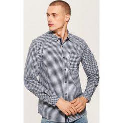Koszula w kratkę - Granatowy. Niebieskie koszule męskie na spinki House, l, w kratkę. Za 79,99 zł.