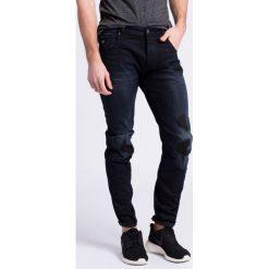 G-Star Raw - Jeansy. Czarne jeansy męskie slim marki G-Star RAW, z aplikacjami, z bawełny. W wyprzedaży za 399,90 zł.