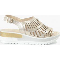 Sandały złote Felicia. Żółte sandały damskie Badura. Za 135,99 zł.