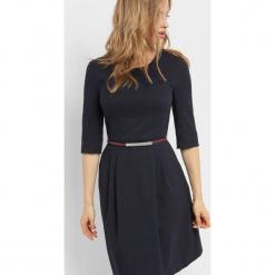 Rozkloszowana sukienka w kratę. Brązowe sukienki na komunię marki Orsay, s, z dzianiny. Za 139,99 zł.