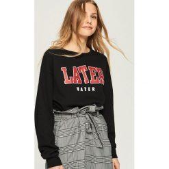 Sportowa bluza z nadrukiem - Czarny. Czarne bluzy rozpinane damskie Sinsay, l, z nadrukiem. Za 39,99 zł.