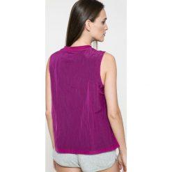 Nike Sportswear - Top. Różowe topy sportowe damskie marki Nike Sportswear, l, z nylonu, z okrągłym kołnierzem. W wyprzedaży za 99,90 zł.