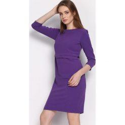 Fioletowa Sukienka Propitious. Fioletowe sukienki Born2be, l, z tkaniny, eleganckie, z okrągłym kołnierzem, z długim rękawem, midi, dopasowane. Za 79,99 zł.