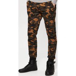 Spodnie dresowe męskie: Spodnie dresowe typu jogger - Beżowy