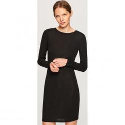 Sukienka z dekoltem na plecach - Czarny. Czarne sukienki na komunię marki Reserved, l, z dekoltem na plecach. Za 89,99 zł.