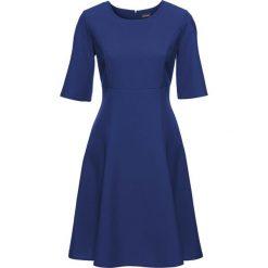Sukienka bonprix ciemnoniebieski. Zielone sukienki na komunię marki bonprix, w kropki, z kopertowym dekoltem, kopertowe. Za 54,99 zł.