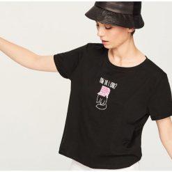 T-shirt z nadrukiem - Czarny. Czarne t-shirty damskie marki Reserved, l, z nadrukiem. Za 24,99 zł.