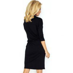 Chantal Sukienka sportowa z golfem - czarna. Czarne sukienki sportowe marki numoco, z wiskozy, z golfem, sportowe. Za 110,00 zł.