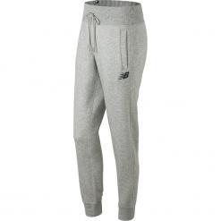 New Balance WP73535AG. Szare spodnie dresowe damskie New Balance, l, z bawełny. W wyprzedaży za 149,99 zł.