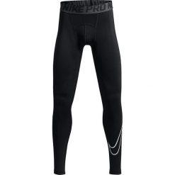 Chinosy chłopięce: Nike Spodnie juniorskie B NP Tight Comp HBR czarne r. XS (128 cm) (726464)