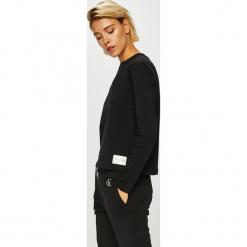 Calvin Klein Jeans - Bluzka. Czarne bluzki asymetryczne Calvin Klein Jeans, l, z bawełny, casualowe, z okrągłym kołnierzem. Za 229,90 zł.