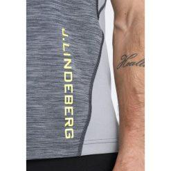J.LINDEBERG SANDY  Tshirt z nadrukiem grey melange. Szare topy sportowe damskie J.LINDEBERG, m, z nadrukiem, z materiału. Za 249,00 zł.
