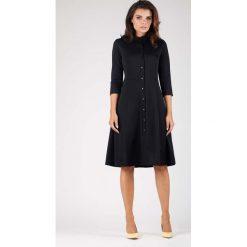 Czarna Klasyczna Sukienka Szmizjerka ze Stójką. Niebieskie sukienki balowe marki ARTENGO, z elastanu, ze stójką. W wyprzedaży za 139,41 zł.