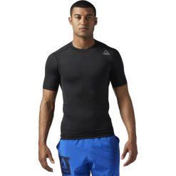 KOSZULA WOR SL SS SLD COMP  BLACK/BLACK. Szare koszule męskie marki Reebok, l, z dzianiny, z okrągłym kołnierzem. Za 89,99 zł.