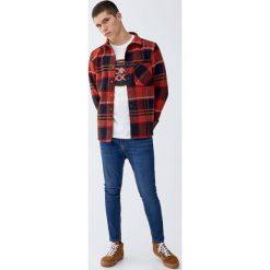 Jeansy carrot fit. Czarne jeansy męskie relaxed fit marki Pull&Bear, m. Za 69,90 zł.