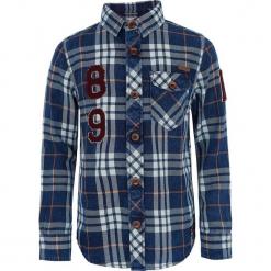 Koszula w kolorze niebieskim. Niebieskie koszule chłopięce Retour Denim de Luxe, z aplikacjami, z bawełny, z klasycznym kołnierzykiem. W wyprzedaży za 125,95 zł.
