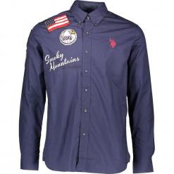 Koszula w kolorze granatowym. Niebieskie koszule męskie marki U.S. Polo Assn., m, z aplikacjami, z bawełny, z klasycznym kołnierzykiem. W wyprzedaży za 260,95 zł.