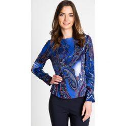 Niebieska bluzka w orientalny wzór QUIOSQUE. Niebieskie bluzki asymetryczne QUIOSQUE, z jeansu, z długim rękawem. W wyprzedaży za 69,99 zł.