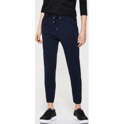 Spodnie dresowe damskie: Dresowe spodnie typu jogger – Granatowy