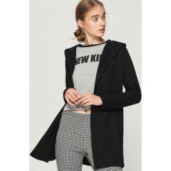 Długa bluza z kapturem - Czarny. Czarne bluzy rozpinane damskie Sinsay, l, z długim rękawem, długie, z kapturem. Za 59,99 zł.