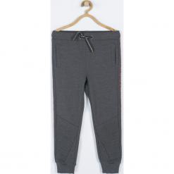 Spodnie. Szare spodnie chłopięce marki Cosmic, z nadrukiem, z bawełny. Za 59,90 zł.