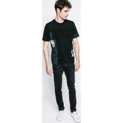 Diesel - Jeansy Tepphar. Niebieskie jeansy męskie slim marki Diesel. W wyprzedaży za 399,90 zł.