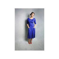 SUKIENKA ABO | Z KIESZENIAMI MIDI KOBALTOWA NIEBIESKA. Niebieskie sukienki na komunię marki Meleksima, l, z materiału, midi, oversize. Za 125,30 zł.