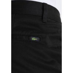 Lacoste Jeansy Slim Fit black. Czarne jeansy męskie relaxed fit Lacoste, z bawełny. Za 469,00 zł.