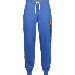 Superman Logo Vintage Spodnie dresowe odcienie niebieskiego. Niebieskie spodnie dresowe męskie Superman, z motywem z bajki, z dresówki. Za 99,90 zł.