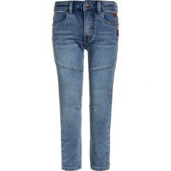 LEGO Wear ICONIC CONSTRUCT  Jeansy Straight Leg light denim. Niebieskie spodnie chłopięce LEGO Wear. Za 169,00 zł.