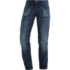 GStar 3301 LOW TAPERD Jeansy Zwężane higa denim. Niebieskie jeansy męskie marki G-Star. W wyprzedaży za 415,20 zł.