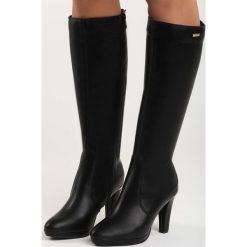 Czarne Kozaki Nastic. Czarne buty zimowe damskie marki Born2be, na wysokim obcasie, na obcasie. Za 84,99 zł.