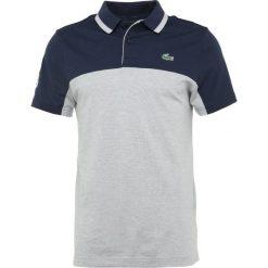 Lacoste Sport RYDER CUP Koszulka polo marine/argent chine. Niebieskie koszulki polo Lacoste Sport, m, z bawełny. Za 499,00 zł.